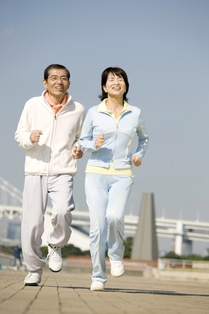 old couple walking: Couples jogging
