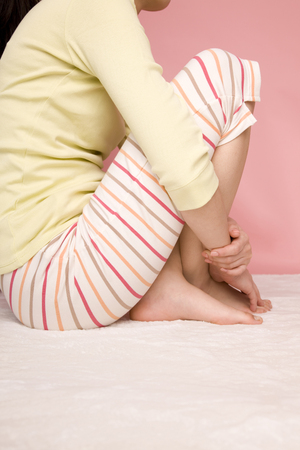 physical education: Feet of women who have a physical education Sitting Stock Photo