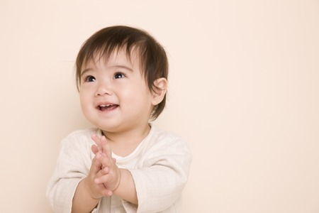Baby pleased by tapping the hand
