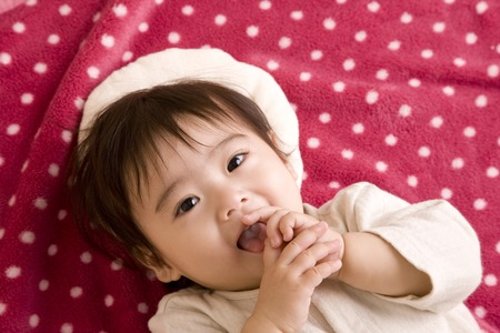 gratification: Baby is lying down Stock Photo