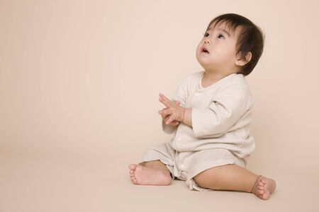 looking at baby: Sitting baby
