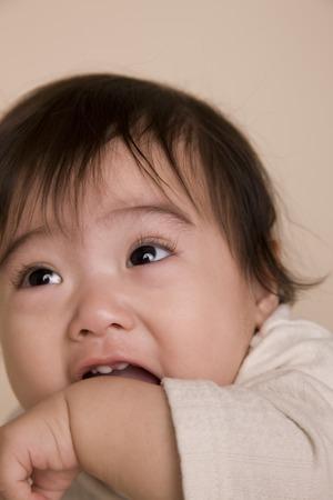 gnaw: Baby gnaw his arm Stock Photo