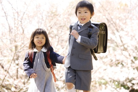Elementary school students of the brother and sister carrying a school bag Stock Photo