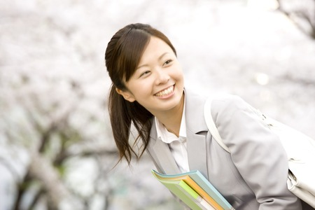acquaintance: Women who greet acquaintance under the cherry tree Stock Photo