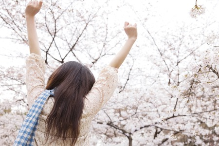 hurray: Rear of women who are raised both hands Stock Photo