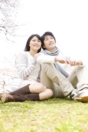 Couple sitting on the grass 写真素材