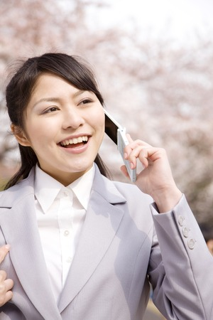 newcomer: Women in conversation on the mobile phone Stock Photo
