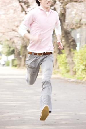 full grown: Man running at full power Stock Photo