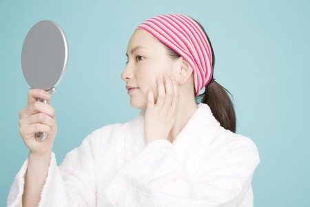 mirror: Woman looking in the mirror Stock Photo