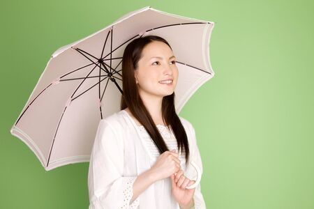 Women with a parasol Stock Photo