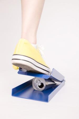 crush: Feet of woman crush empty cans