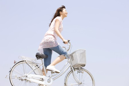 pleasent: Woman riding a bicycle