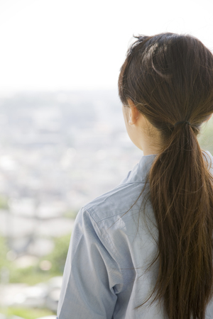 rear view: Rear View of woman stare far Stock Photo