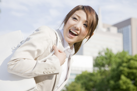 to be pleasant: Woman smiling while greeting