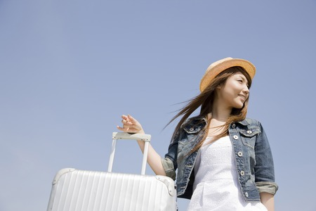 people travelling: Women who have a carry back