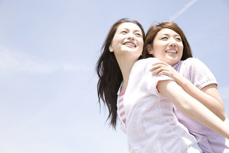 pleasent: Two women laughing joking with each other