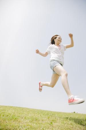 Women run down the hill