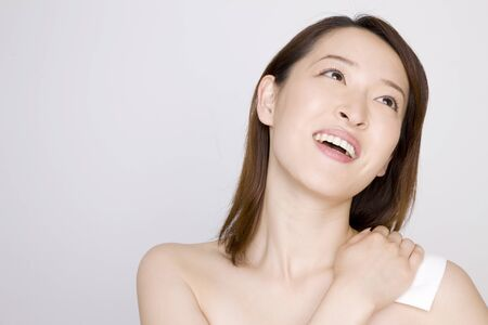 japanese people: Women who put a poultice on the shoulder Stock Photo