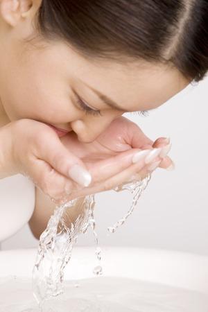 wash: Woman wash face Stock Photo