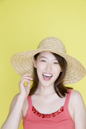 straw hat: Woman wearing a straw hat Stock Photo