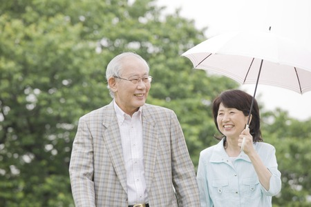 parasols: Elderly couple for a walk with parasols