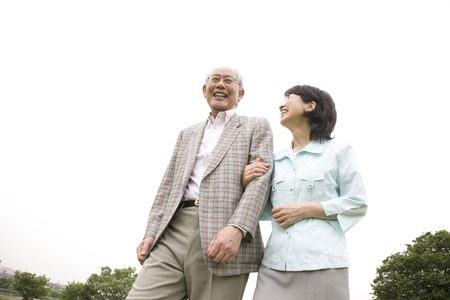 riverbed: Elderly couple to walk in the riverbed while draw arm Stock Photo