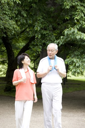 Elderly couple to the marathon in the park Banco de Imagens