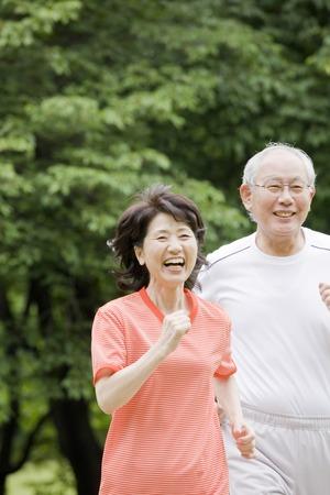 Elderly couple to the marathon in the park Stock Photo