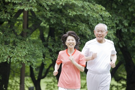 senior old: Elderly couple to the marathon in the park Stock Photo