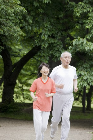 Elderly couple to the marathon in the park Stock Photo