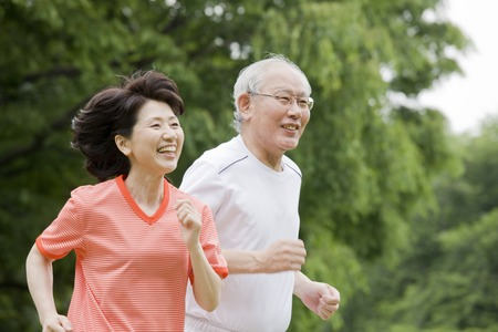 asian old man: Elderly couple to the marathon in the park Stock Photo