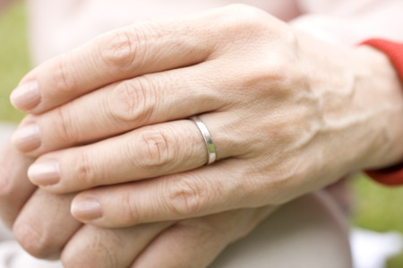 mutually: Hand of an elderly couple mutually accompanied by a hand Stock Photo