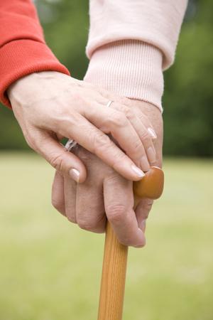 mutually: Hand of an elderly couple mutually accompanied by a hand wand