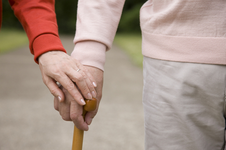 married couples: Hand of an elderly couple mutually accompanied by a hand wand