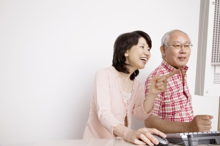 personal computer: Elderly couple to operate the personal computer