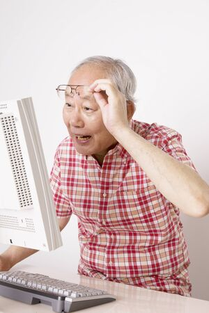 personal computer: Old man is surprised to see the personal computer