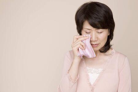 handkerchief: Woman wiping tears with a handkerchief Stock Photo