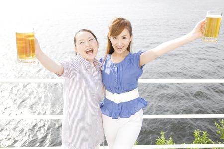 seawater: Two women toast Stock Photo
