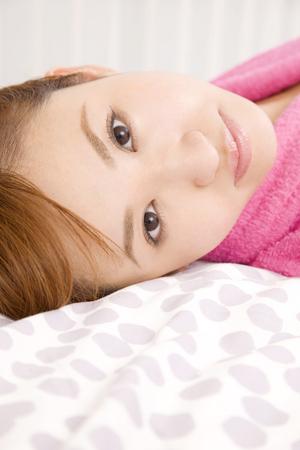 oriental bathrobe: Women lie on the bed wearing a bathrobe