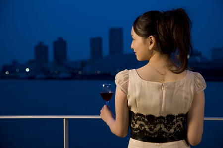 Women who drink wine on the terrace Stock Photo