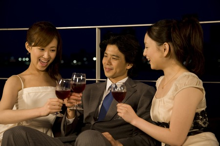 Men and women to enjoy the party on the terrace Stock Photo