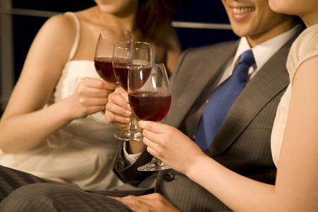 Men and women to toast with wine