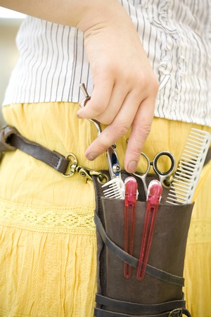coiffeur: Hand of the hairdresser with scissors