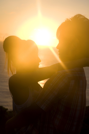 mutually: Silhouette of a couple that are mutually hug at dusk