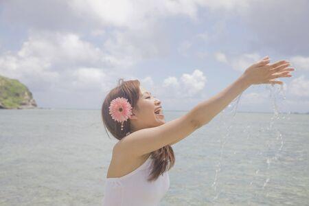 seawater: Women scoop the seawater by hand