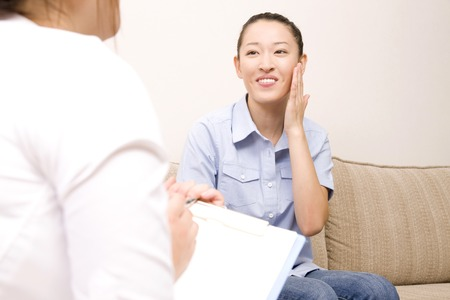 Women undergoing counseling in beauty salon