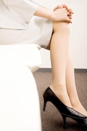 crosslegged: OL it is cross-legged sat in a chair Stock Photo