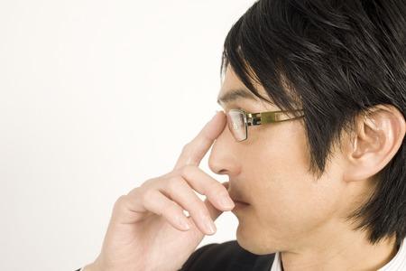 メガネをかけるビジネスマン 写真素材
