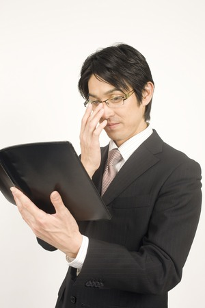 handbook: Businessmen have a handbook Stock Photo