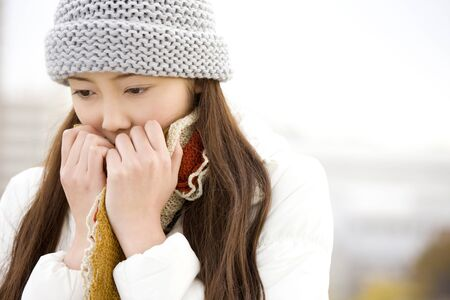 Beat the cold weather women Stock Photo